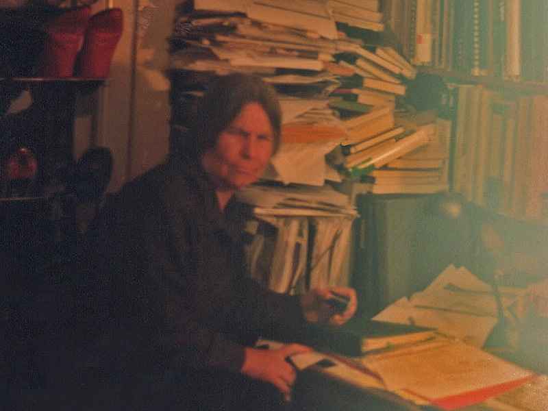 image of Frances, scowling, with books