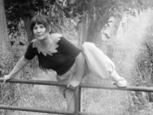Frances climbs over iron gate